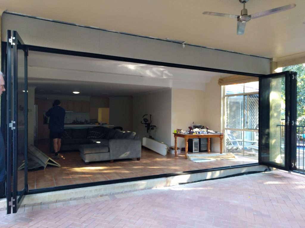 Chermside West after Photo of seven panel black aluminium bifold doors